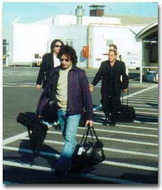 Eric Singer, Paul Stanley & Doc McGhee at Adelaide Airport - Photo by Dave Adams