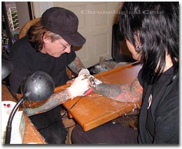 Tattooing Nikki's hand at the Sixx residence